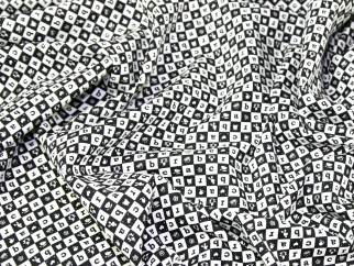 one metre cotton poplin with squares with pirate designs