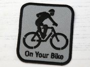 On Your Bike Embroidered Iron On Motif Applique  Grey